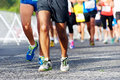 People running marathon race competing in fitness and healthy active lifestyle feet on road Royalty Free Stock Image