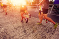 People running marathon race competing in fitness and healthy active lifestyle feet on road Royalty Free Stock Photos