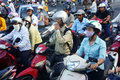 People in rush hour sai gon viet nam march wear helmet and ride motorbike moving with confusion at Stock Photo