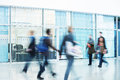 People rushing through corridor motion blur image of walking Royalty Free Stock Photography