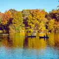 People salong on boats on the lake in New York City Central Park at autumn season time Royalty Free Stock Photo