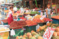 People selling and buying food in a traditional fruit and vegetable market of Taiwan Royalty Free Stock Photo
