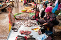 People selling food at marketplace cambodia siem reap dec unidentified khmer woman and her son fish on dec in siem reap street Stock Image