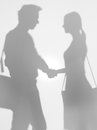 People shaking hands, silhouette Stock Photo
