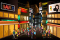 People shopping at night a vector illustration of a busy city center Royalty Free Stock Image