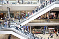 People shopping in retail mall and using escalators the modern bullring centre birmingham uk Stock Image