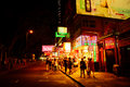 People, shops and neon signs in Hong Kong Royalty Free Stock Photography
