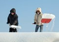 People shovelling snow on a roof Royalty Free Stock Images