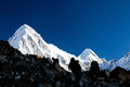People silhouette hiking in mountains hikers himalaya over pumo ri snow high peak Stock Photo