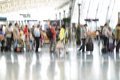 People silhouettes in motion blur, airport interior Royalty Free Stock Photo