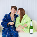 People sit at home on sofa with fizz Royalty Free Stock Photo