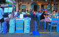 People sit in sidewalk street cafe in Chania waterfront on Crete