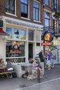 People sitting at Bulldog coffeeshop on the street in Amsterdam