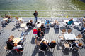 People sitting in the outdoor restaurant on the pier in Kolobrzeg Royalty Free Stock Photo