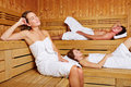 People sitting relaxed in sauna Stock Photos