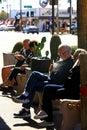 People sitting on a sidewalk bench enjoy the delights of a milkshake in Scottsdale AZ Royalty Free Stock Photo