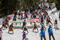 People skiing dressed with traditional bulgarian clothes. Royalty Free Stock Photo