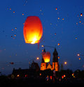 People and sky lanterns on kupala night in poznan poland celebrate the shortest of the year this yearly Royalty Free Stock Images