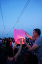 People and sky lanterns on kupala night preparing lantern in the city celebrate the shortest of the year this yearly Royalty Free Stock Photos