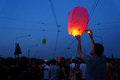 People and sky lanterns on kupala night preparing lantern in poznan poland celebrate the shortest of the year this yearly Royalty Free Stock Images