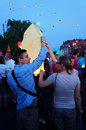 People and sky lanterns on kupala night preparing lantern in poznan poland celebrate the shortest of the year this yearly Stock Photo