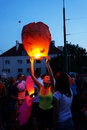 People and sky lanterns on kupala night preparing lantern in poznan poland celebrate the shortest of the year this yearly Stock Images