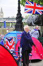 People sleep in a tent alongside the river thames london june unidentified to witness diamond jubilee boats parade on june Stock Image