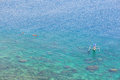 People snorkeling in turquoise water on bali the eastern coast of Stock Image