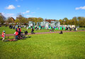 People spending their day off at glasgow green place kids and adults enjoy time on an inflatable stonehenge life sized inflatable Royalty Free Stock Images