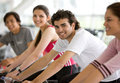 People spinning at the gym Royalty Free Stock Images
