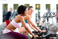 People spinning in the gym on bicycles young women fitness Royalty Free Stock Photography