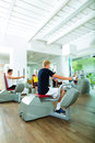 People in sport gym on machines group of men train machine a fitness club or Stock Photo