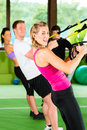 People in sport gym on suspension trainer Stock Image