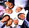 People standing in huddle, smiling, low angle view Royalty Free Stock Photos