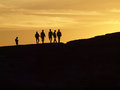 People standing in sunset Royalty Free Stock Photo