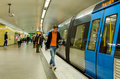 People at stockholm subway travelling in station getting on the train Royalty Free Stock Image