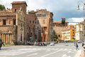 People on street near the picturesque ancient building in rome italy may italy Stock Images