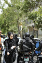 People in the street of tehran traditional dressed iran woman and some policemen close to bazzar Stock Photography