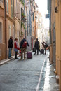 People on the streets of marseille old town france october arriving to hotel in narrow street taken in france october Stock Images