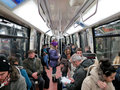 People in subway train wagon interior Royalty Free Stock Photo