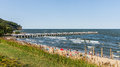 People sunbath on a beach in orlowo district of gdynia former fishermen village founded in main attractions are maritime cliffs Stock Photo