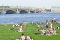 People sunbathe on the lawn Royalty Free Stock Photo