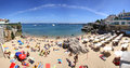 People sunbathing on the beach in cascais portugal june praia da rainha june is famous and popular Royalty Free Stock Images
