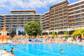 People swim in pool of hotel Flamingo Grand Hotel at summer. Albena, Bulgaria