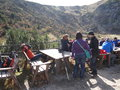People by tables resting in the mountains Royalty Free Stock Images