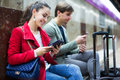 People With Tablet At Metro