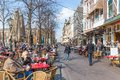 People take a drink at the terraces of Het Plein near the Dutch Government buildings of The Haque Royalty Free Stock Photo