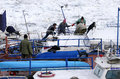 People take out trapped boat from the frozen Danube river