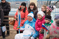 People take photographs of the torchbearer in a wheelchair tver russia march paralympic torch relay tver involved Stock Image