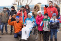 People take photographs of the torchbearer in a wheelchair tver russia march paralympic torch relay tver involved Royalty Free Stock Photography